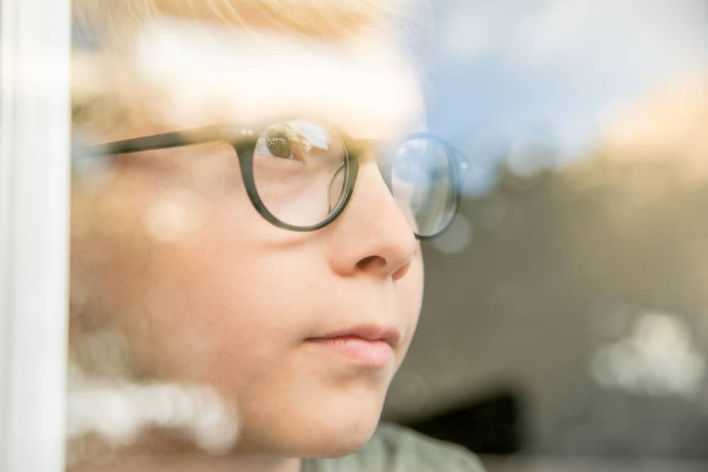 child with glassees